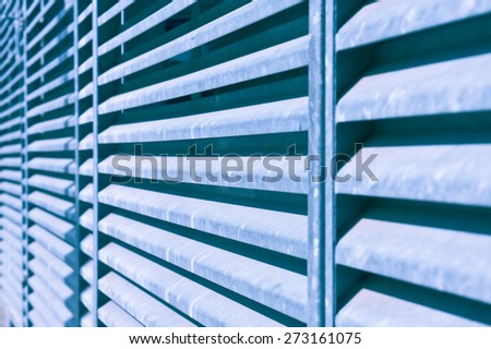 Metal bars with a shallow depth of field as an abstract image in blue monochrome - stock photo