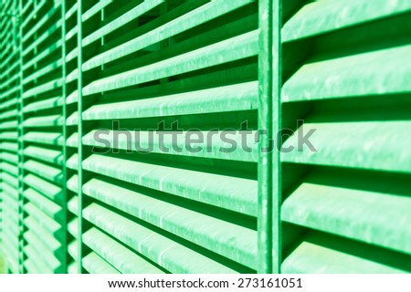 Metal bars with a shallow depth of field as an abstract image in green monochrome - stock photo