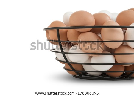 Metal basket filled with brown and white farm fresh - stock photo