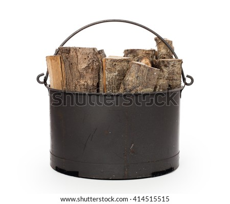 Metal basket of firewood, isolated on white - stock photo