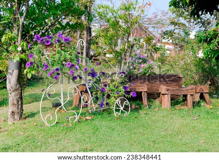 Metal bicycle model on the small garden of country house. - stock photo