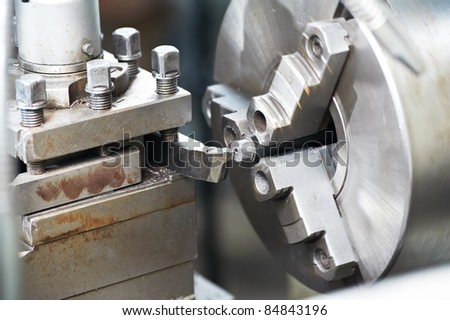 metal blank machining process on lathe with cutting tool