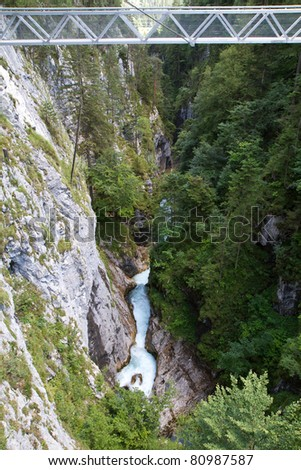 Metal bridge inside the Leutasch Gorge in the German alps, Bavaria - stock photo