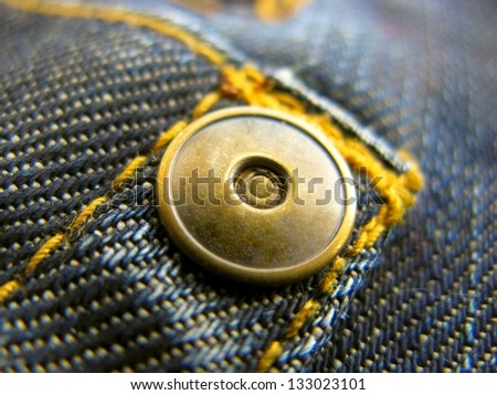 metal button on jeans close up - stock photo