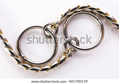 metal chain closeup on a white background - stock photo