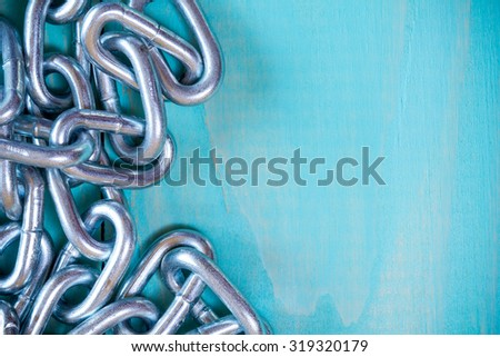 Metal chain on nice wooden background with copy-space - stock photo