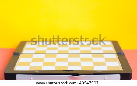 Metal chessboard without figures concept on colorful background - stock photo