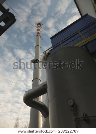 metal chimney on the background of blue sky - stock photo