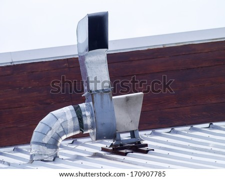 Metal chimney on the roof . - stock photo