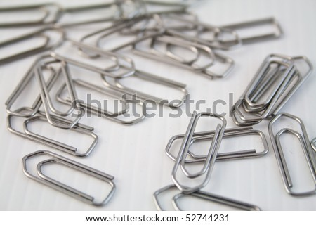 Metal clips on a white ground
