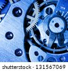 metal clock mechanism with the gears - stock photo