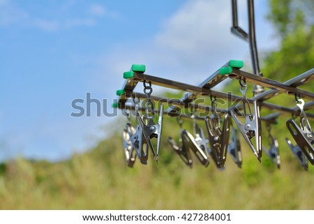 Metal clothespins in the noon daylight - stock photo