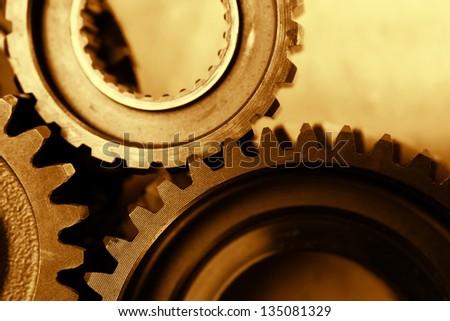 Metal cog gears bonding together - stock photo