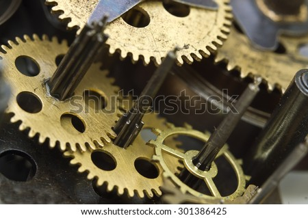 Metal Cogwheels Inside Old Clockwork to success concept for your technology design. Macro