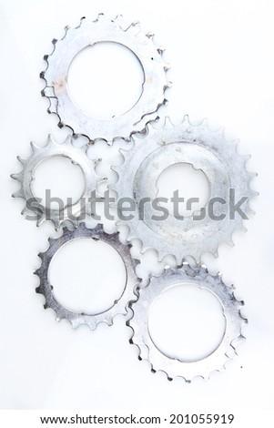 Metal cogwheels isolated on white - stock photo