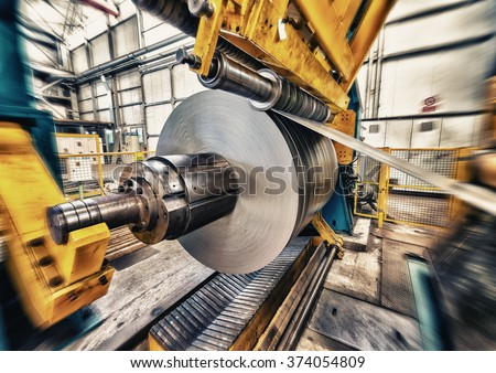 Metal coils machine. Interior of factory. Business concept. - stock photo