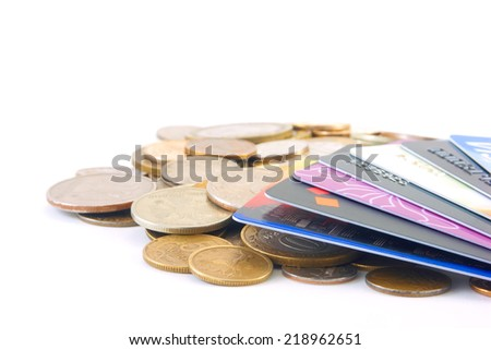 Metal coins and credit cards - stock photo