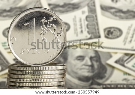 Metal coins on the background of US dollars - stock photo