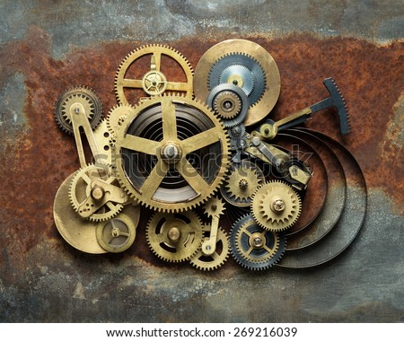 Metal collage of clockwork on rusty background - stock photo