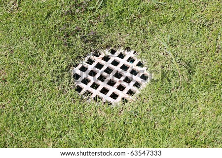 metal cover of drain on filed. - stock photo