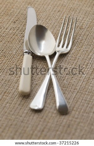 metal cutlery on rustic table