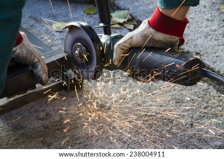 metal cutting with the angle grinder - stock photo