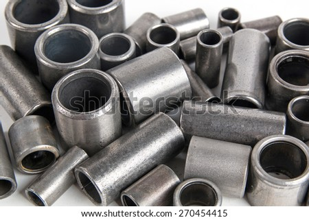 Metal cylinders - elements of the industrial roller chain isolated on white background - stock photo