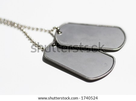 Metal dog tags / side view - stock photo