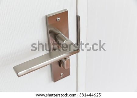 Metal door handle. - stock photo