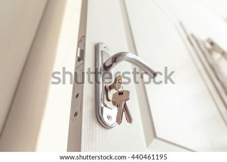 Metal door knob and keys closeup - stock photo