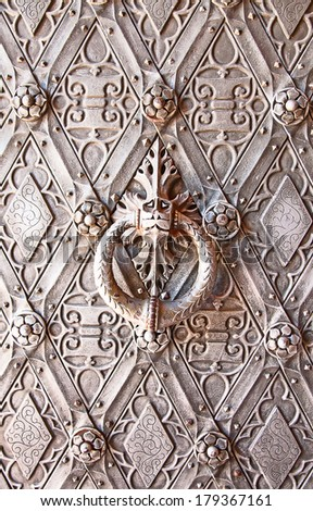 Metal door of the ancient castle - stock photo