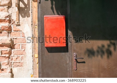 Metal door with mail box and place for inscription - stock photo
