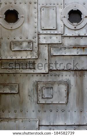 metal door with porthole - stock photo