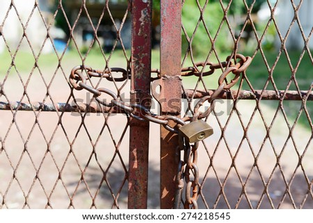 Metal door with rusty chain and key locked. Concept security - stock photo