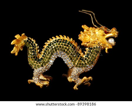 Metal dragon with crystals on the black background (souvenir) - stock photo