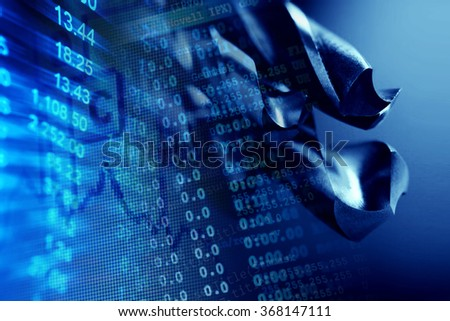Metal drill bits and cnc data. Drilling and milling industry. Macro image. - stock photo