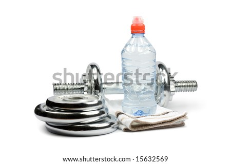 Metal dumbbell with bottle of water, towel and weights. Isolated on white - stock photo