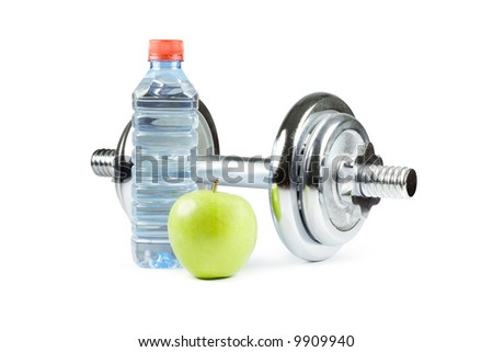 Metal dumbbell with green apple and bottle of water. Isolated on white - stock photo