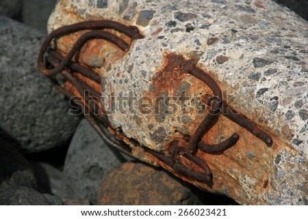 metal embedded in cement - stock photo