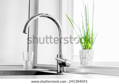 Metal faucet in a kitchen - stock photo