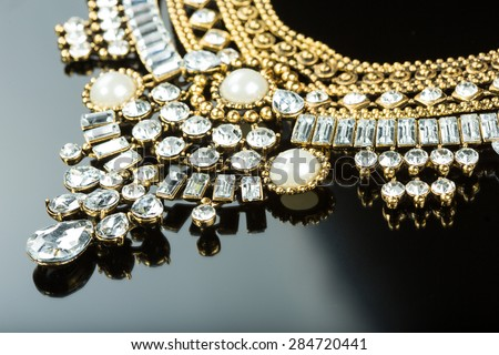 metal feminine necklace. on black  background.  - stock photo