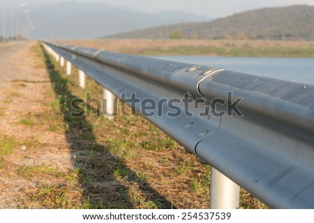 Metal fence at the boundary curb and prevent accidents. - stock photo
