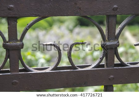 Metal fence with blurred background - stock photo