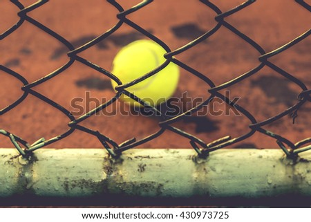 Metal Fence with court in the Background / steel mesh with the ground and white line tennis court background / steel mesh at tennis court