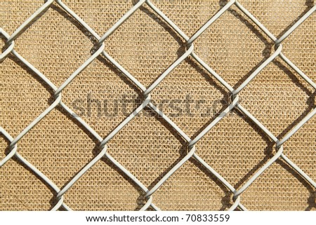 Metal fence with the light brown background - stock photo