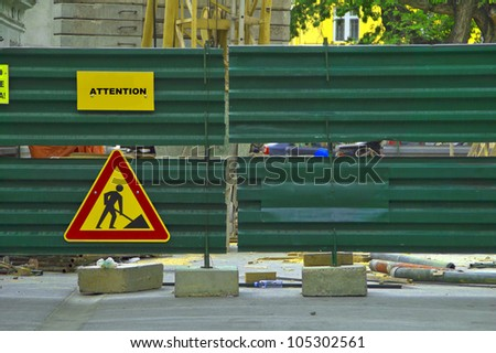 Metal fence with under construction sign - stock photo