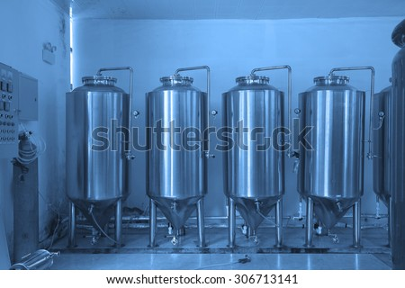 Metal fermentation barrel for the equipment in Grape winery brewing workshop.  - stock photo