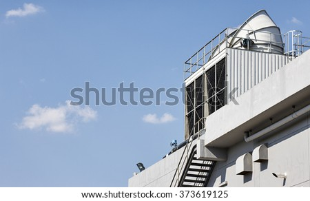 Metal fire escape or emergency exit on Grey Wall of Building