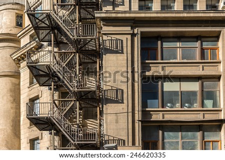 Metal Fire Escape Stairs On Old Building Facade - stock photo
