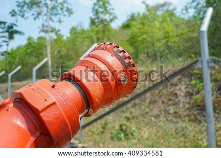 Metal fire hose nozzle - stock photo